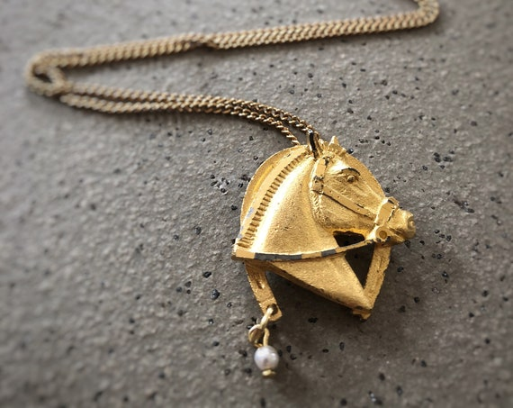 Upcycled gold-toned horse head pendant with pearl drop and gold-toned chain