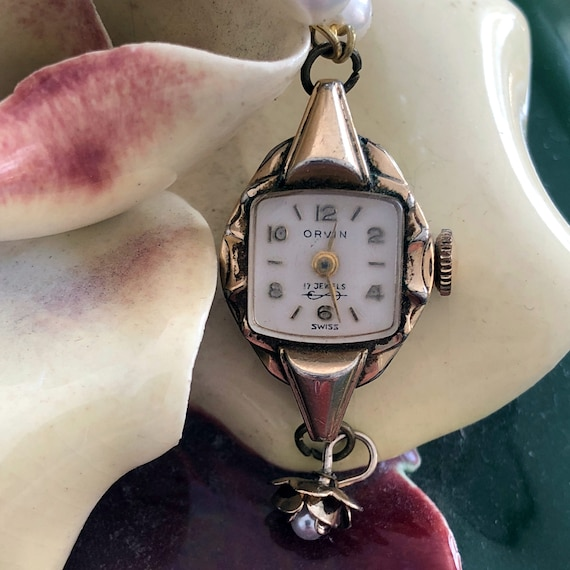 Vintage Orvin Watch Case Pendant Necklace with Gold and Pearl Flower Charm - 10K Rolled Gold - Midcentury
