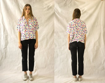 Summer blouse with colourful floral pattern