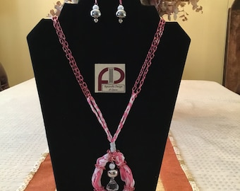 Hand-woven ribbon necklace and pink chain with central bead