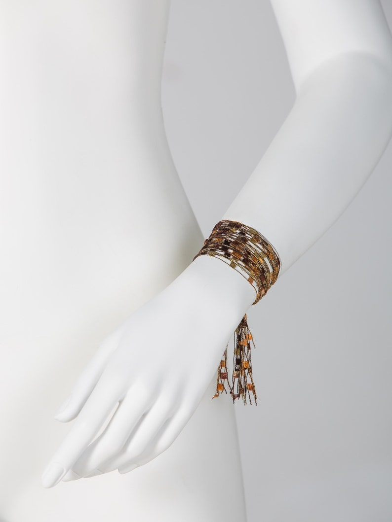 soft Multi-threaded bracelet with magnetic clasp Brown Golden Color lightweight Bright durable and easy to use.