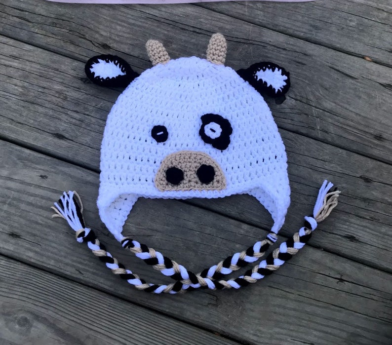 Crochet cow beanie hat with ear covers and braids  8c18ce17f8e