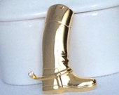 Vintage gold tone plain tall boots with single set-in rhinetone close to the leg calf.