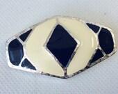 Vintage cloisonné off-white and blue enamel silver tone metal brooch.