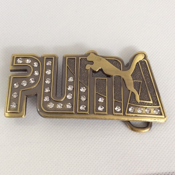 Woman's Vintage Statement Puma belt buckle.