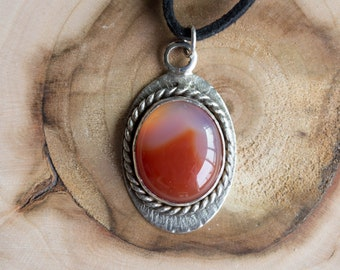 Carnelian and silver pendant on faux suede cord