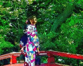 Geisha girl in gardens of Kyoto Japan