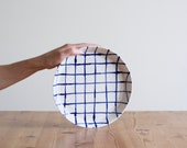 Grid rimmed dinner plate | Fine porcelain ceramic hand painted modern blue grid serving plate