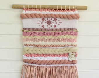 Pink woven wall hanging