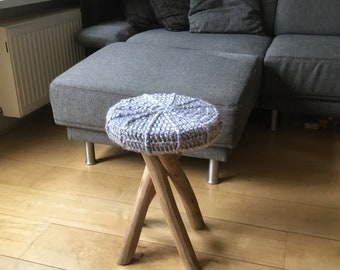 Wooden stool with crocheted seat