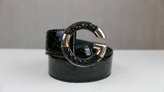 Black Gucci patent leather monogram belt