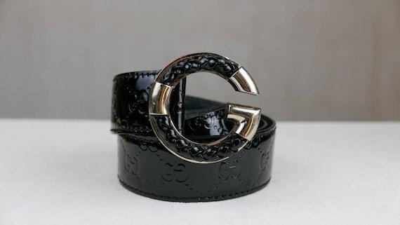 Black Gucci patent leather monogram belt