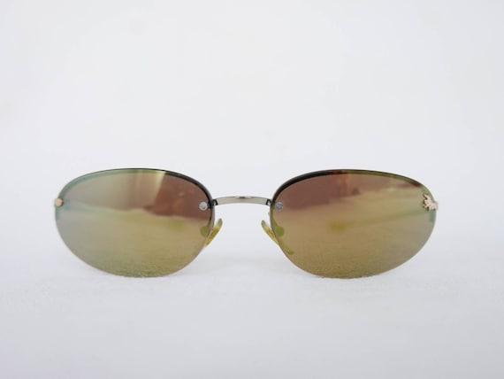 90s Nina Ricci rimless sunglasses
