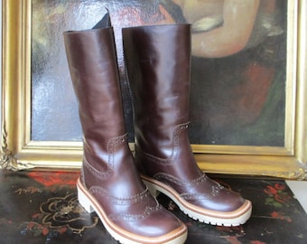 d1a2d33d3c01 Brown boots by Miu Miu