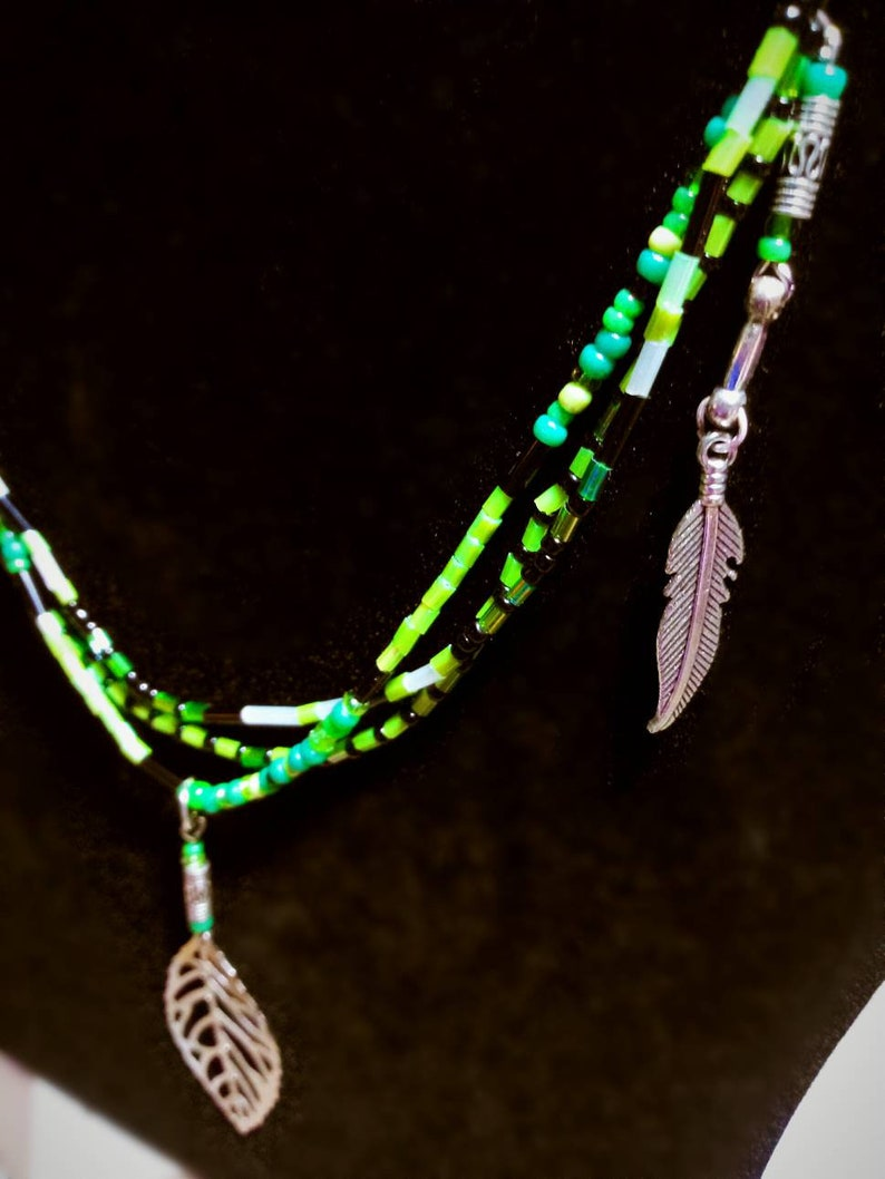 Green glass beaded necklace with silver feathers and leaf charms native american handmade jewelry