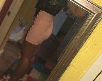 Pink lace up mini skirt