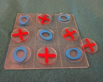 Acrylic noughts and crosses game