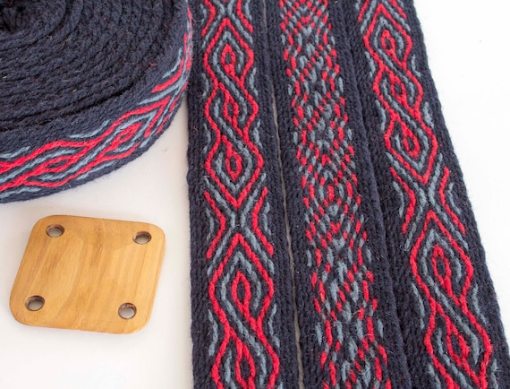 Dark blue Viking reenactment red and brown. Tablet woven wool trim