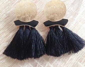 Black fringe and gold tone earrings