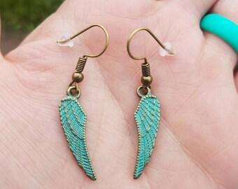 Angel wing brass dangle earrings