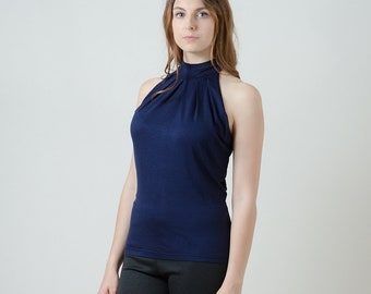 Sleeveless Sirt with elegant folding on the neck cuff