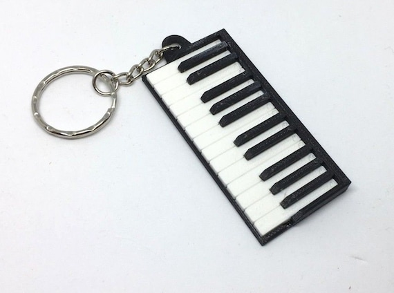 The Musical Our House Keyring Bag Tag.