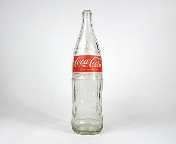 vintage and//or unusual Coca Cola Collectible Bottles empty or full