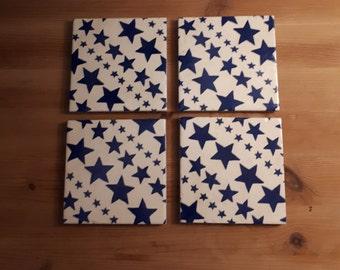 A set of four ceramic tile coasters