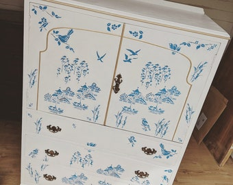 Hand stencilled willow pattern on TV style cabinet with draws