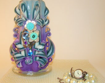 Carved turquoise purple candle