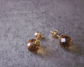gold earrings and topaz , sphere. precious stones, 18kt gold
