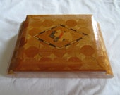 Wooden box cigarette box with terrier dogs in marquetry on top, perhaps Sorrento
