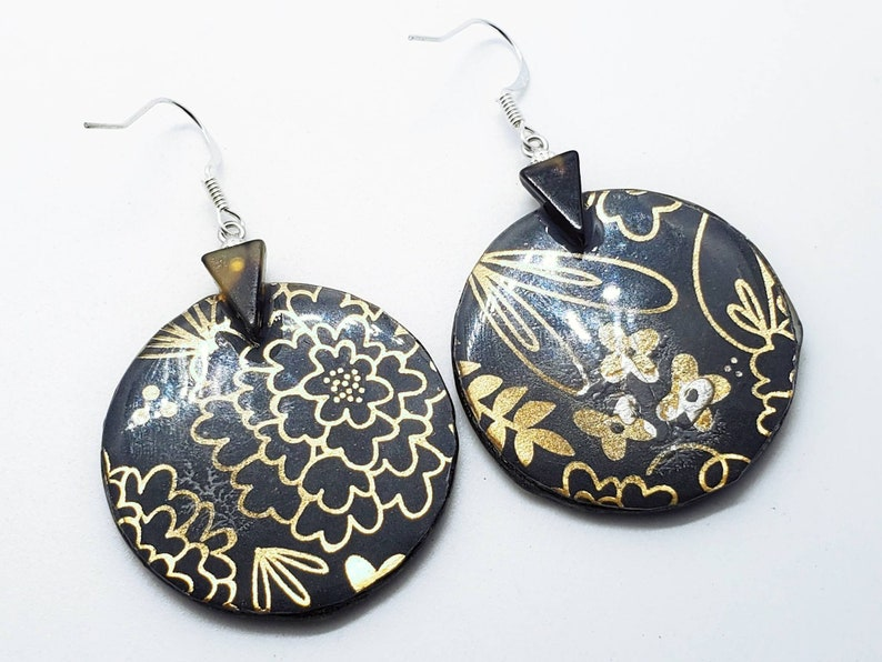 incredibly lightweight Hand painted on wood womans eye and lips with ink and acrylic sealed in resin earrings and silver hooks