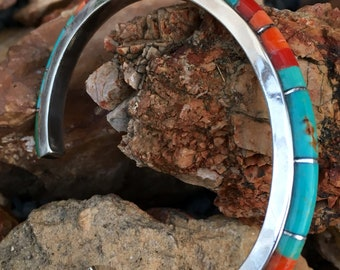 Stering silver cuff inlaid by verious real american turquoise and red coral.