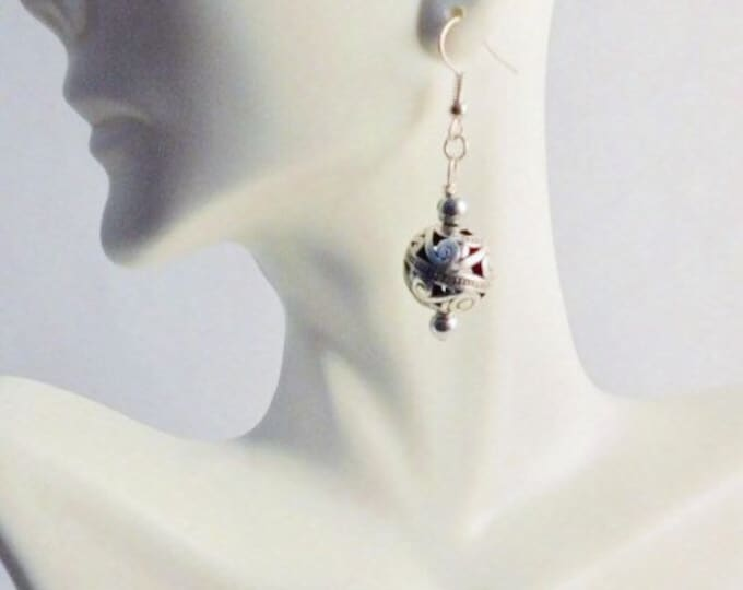 Silver beaded dangle earrings