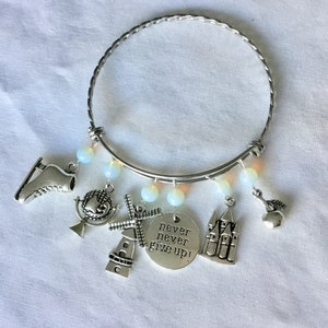 ice skates windmill and more also Opal beads. Charm bracelet featuring Scandinavian Dutch themes