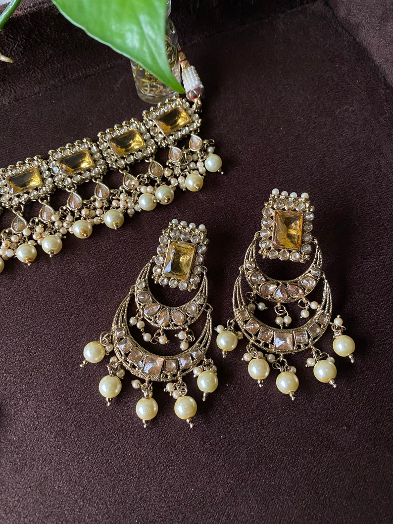 Gold choker set with earrings and tikka