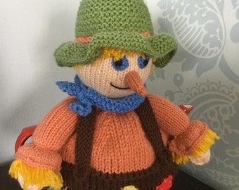 Knitted scarecrow tea cosy