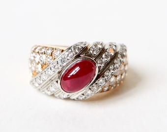 TABBAH 18 KT yellow gold ring and platinum adorned with a cabochon ruby and diamonds