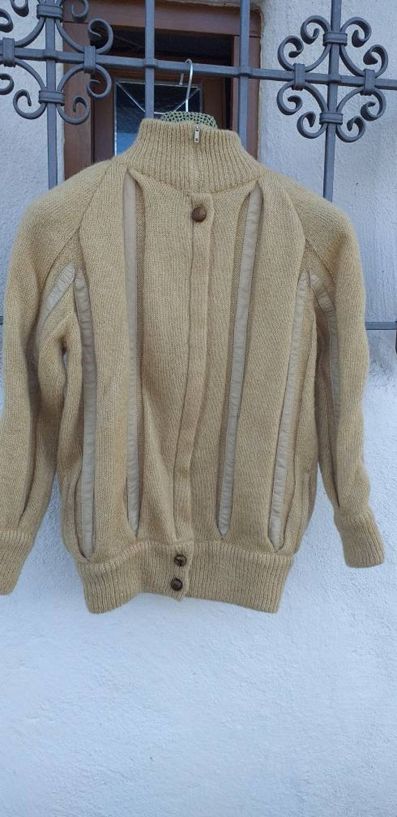 Wool cardigan with leather inserts
