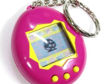 Tamagotchi Original Gen 1 English Magenta & Yellow Button 1996 - 1997 Bandai Japan Virtual Pet