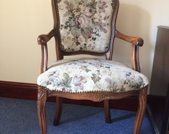 Antique-style open armchair on cabriole supports