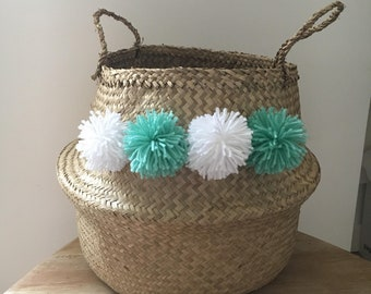 Wicker basket with colorful tassels