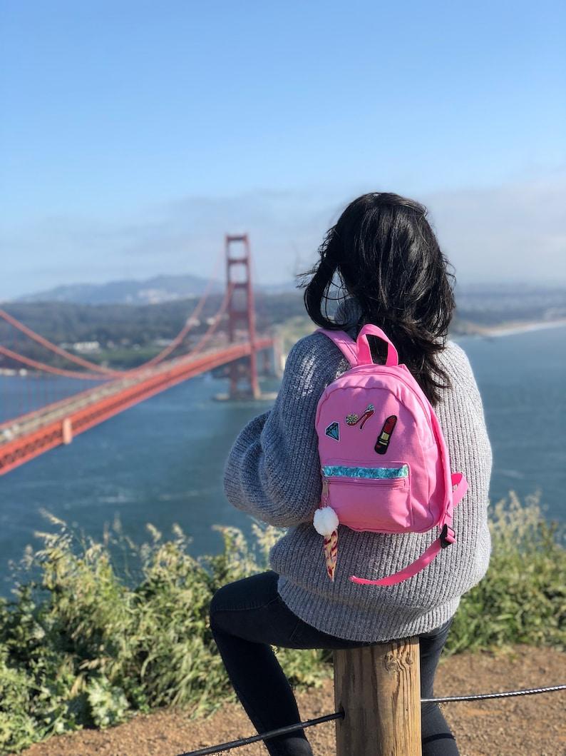 3.5 W x 8 L x 11 H Wanderlust Canvas Mini Backpack