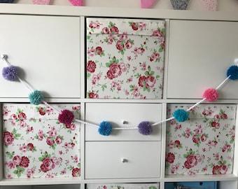 Multicoloured pompom bunting