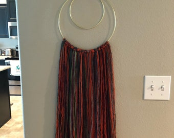 Handmade double-ring, multicolored yarn wall hanging