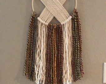 Handmade warth tone criss cross yarn wall hanging