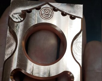 Copper bottle opener with key ring holes