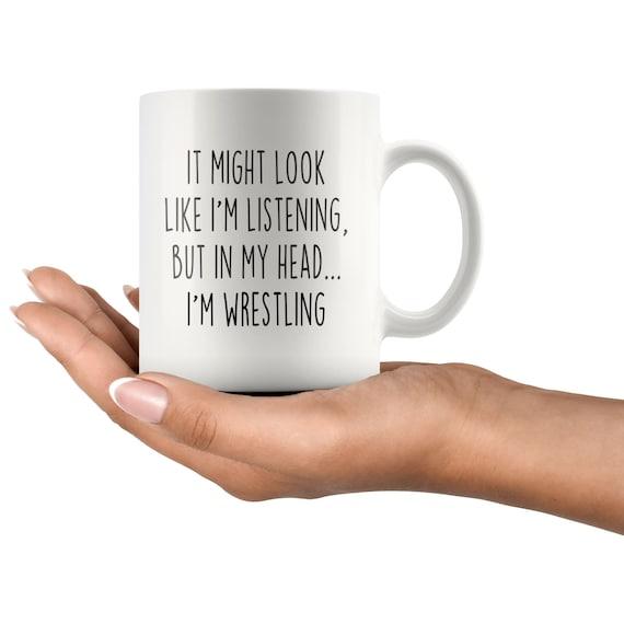 Wrestling  Mug Black I May Look Like Im Listening