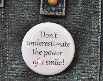 """Don't underestimate the power of a smile - 2.25"""" button - quotes - inspiring words - pinback buttons - pins - badges"""